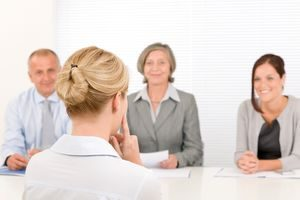 Business Interview Young Woman Being Examined By Professional Manager Team