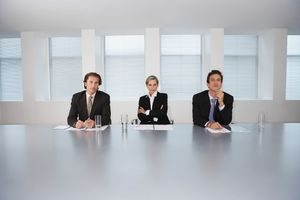Hiring Managers Sitting In Conference Room