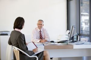 Two Businesspeople Having Meeting In Office