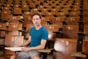 Portrait Of A Young University Student Sitting In A Lecture Hall
